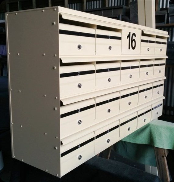 BANK OF 19 COMMERCIAL MAILBOXES + NUMBER PANEL